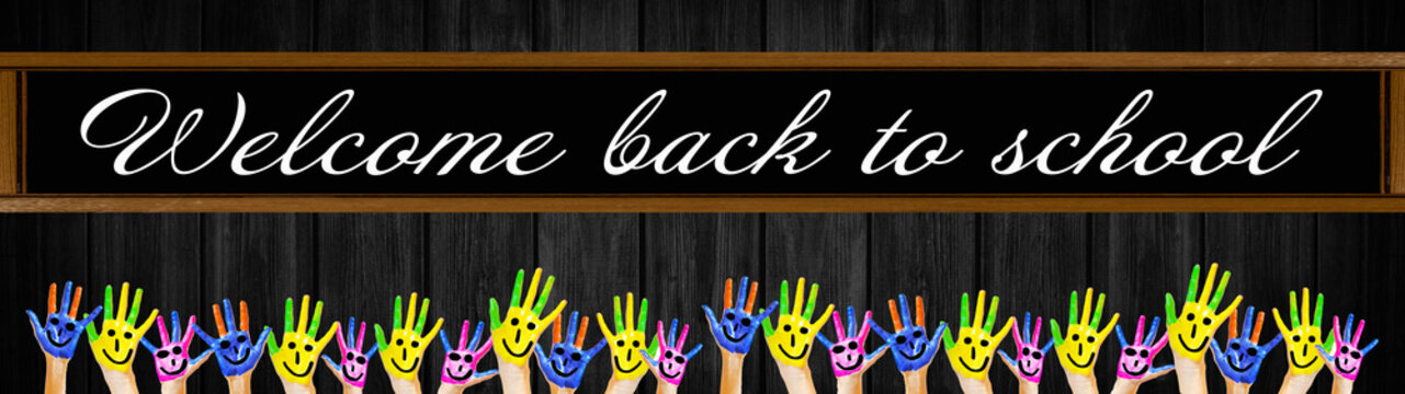 """School background banner panorama - School board with lettering """"welcome back to school"""" and many brightly painted waving children's hands, isolated on black rustic wooden wall texture"""