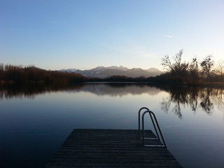 Jetty Leading To Calm Lake