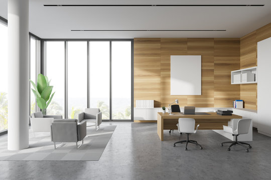 White and wood CEO office with lounge and poster