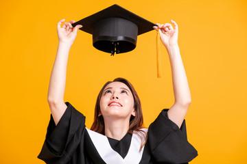 beautiful young female graduation looking the  graduate cap