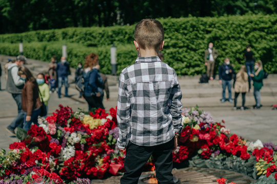 Kiev, Ukraine, May 09, 2020: people take part in the celebration of the memory of loved ones who died in World War II in the Park of Eternal Glory. Celebration of Victory Day during COVID-19 pandemic