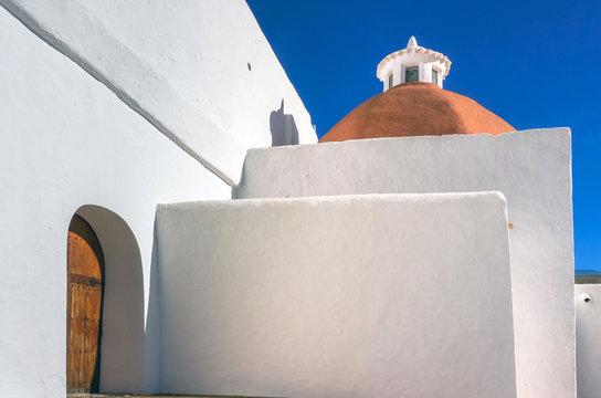 Mediterranean traditional architecture in Ibiza: white small church in Santa Eularia des Riu