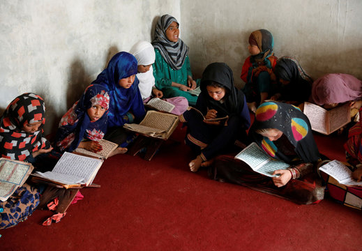 Internally displaced Afghan girls read the Koran at a mosque, amidst the spread of the coronavirus disease (COVID-19) during the holy fasting month of Ramadan, in Kabul