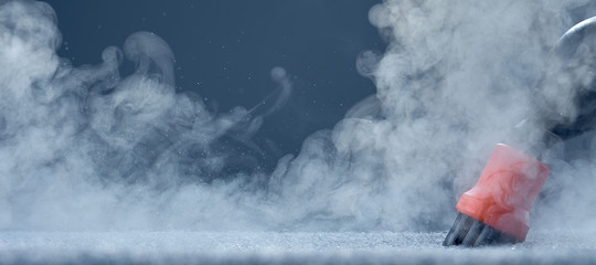 Steam close-up. Steam carpet cleaning on blue background. Home cleaning. Photo with copy space.