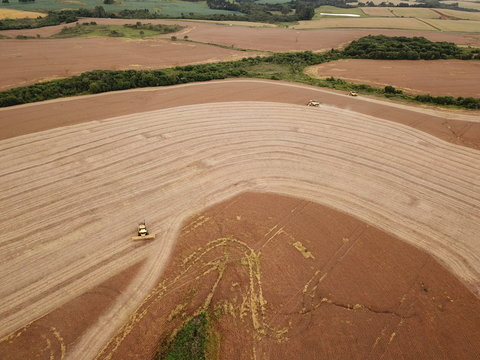 Aerial image of a combine harvester harvesting soybeans in brazil