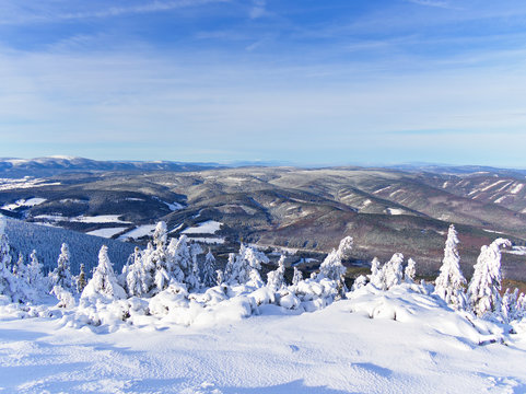 Beautiful view over the top of snow covered Serak mountain in Czech Republic