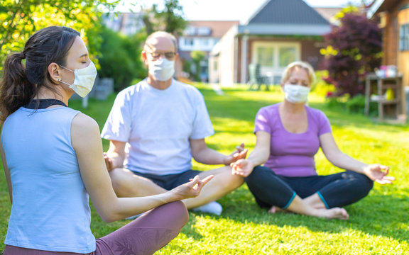 Group session of yoga with face masks - meditation lesson in a nursing home during or after corona virus (covid-19) outbreak