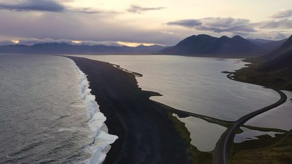 Wall Mural - Flying over a black sand beach and the Ring Road in Iceland