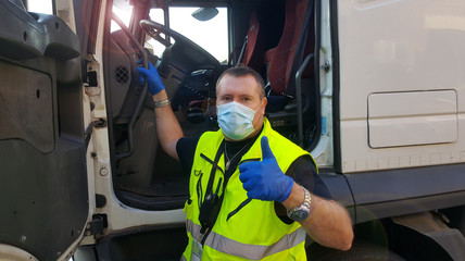 young transporter on the truck with face mask and protective gloves for Coronavirus