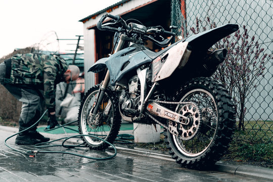 27 March 2020 Wroclaw - Motocross Yamaha WR 250r has been washed by young man. Motorcycle stands in front of a garage. Motorcycle being prepared for a ride.