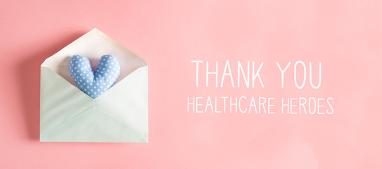 Foto op Aluminium Londen Thank You Healthcare Heroes message with a blue heart cushion in an envelope