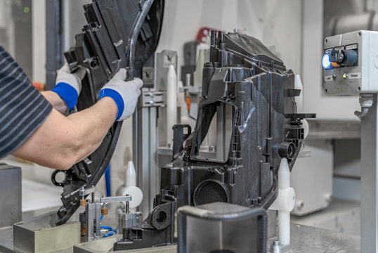 assembly of plastic molds on the production line in the factory