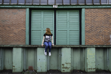 Girl in front of old ware house