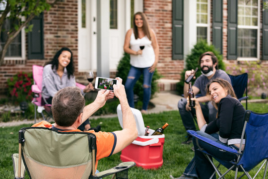 Distanced: Man Takes Photo Of Friends At Party During Pandemic