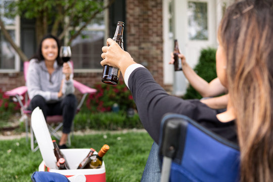 Distanced: Friends Share Toast While Staying Apart During Virus Party