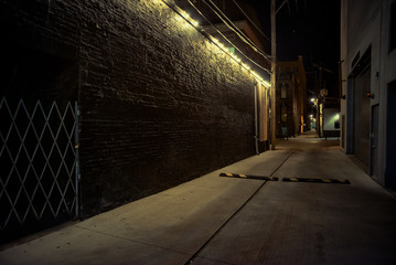 Wall Mural - Dark and eerie urban city alley at night