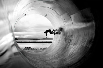 Person Skateboarding In Tunnel