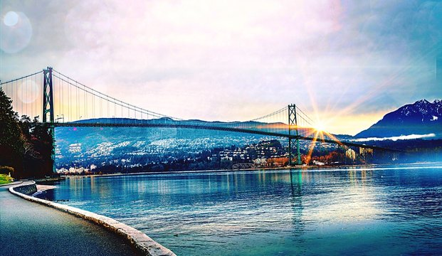Low Angle View Of Lions Gate Bridge Over River During Sunset