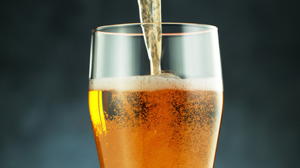 Fototapete - Close up of a wet pint of cold pale beer pouring