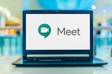 Laptop computer displaying logo of Google Meet