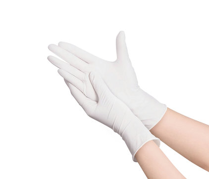 Two white surgical medical gloves isolated on white background with hands. Rubber glove manufacturing, human hand is wearing a latex glove. Doctor or nurse putting on nitrile protective gloves
