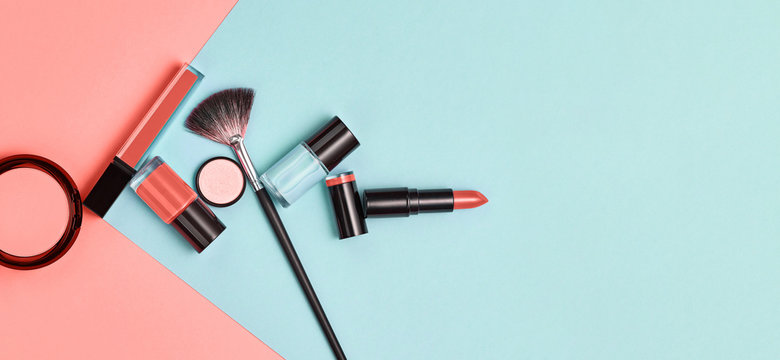 Beauty cosmetic makeup set. Fashion woman make up product, brushes, lipstick, nail polish pop art, flat lay. Creative vivid concept. Cosmetology make-up accessories banner, top view