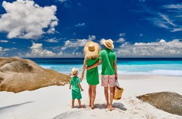Wall Mural - Family with three year old boy on beach. Seychelles, Mahe.