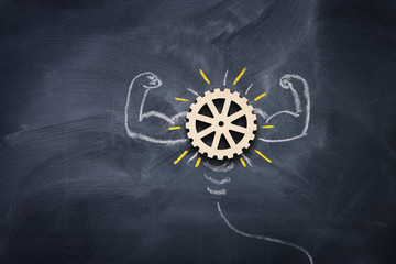 Education concept image. Creative idea and innovation. Wooden gears light bulb metaphor over...