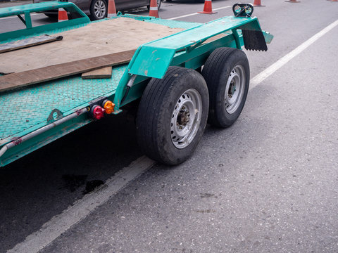 transporting small  cargo trailer for a car strapped