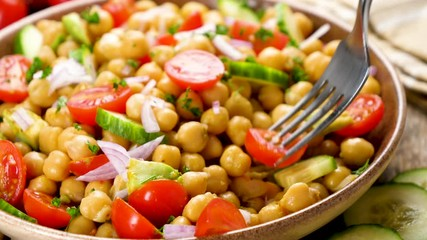 Fototapete - chickpea salad with cucumber, tomato and onion- eating vegetable salad