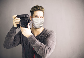 photographer with camera and face mask