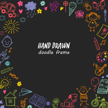 Hand drawn doodle children drawing round frame on a blackboard background