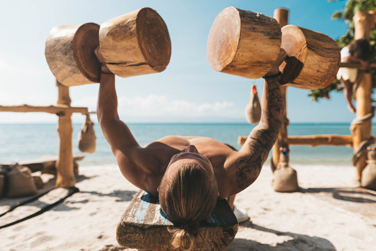 Man training in Eco gym on the beach