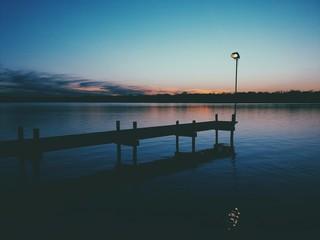Jetty On Lake At Dusk