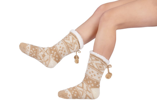 Women's brown sherpa winter socks with legs on white background