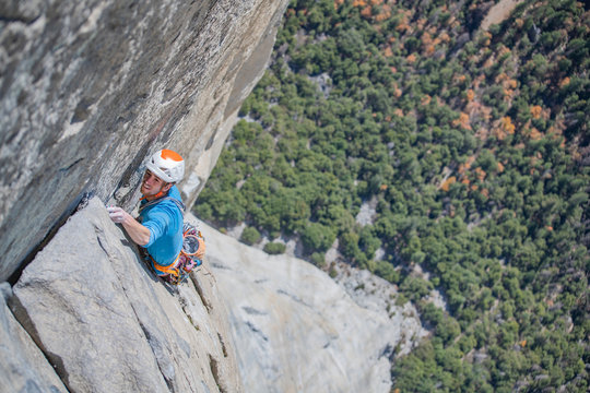 Rock climber climbing at top of El Capitan very exposed on the Nose