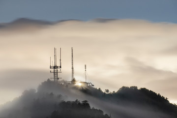 View of radio towers on Mount Wilson during fog