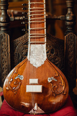 Close up photo of a sitar, traditional Indian musical instrument
