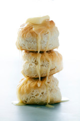 Stack of Buttermilk Biscuits with Butter Dripping