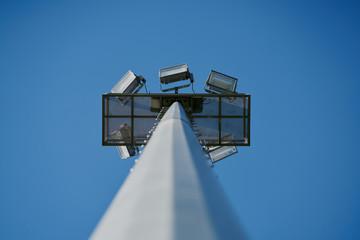 daytime stadium lights seen from below
