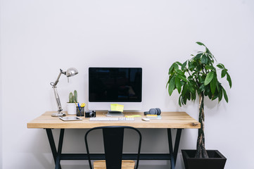 Modern creative home workspace with computer