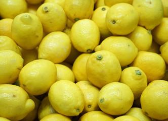 Wall Mural - fresh yellow lemon pile as food background