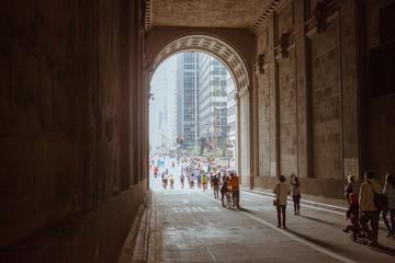 People Walking In Historic Building