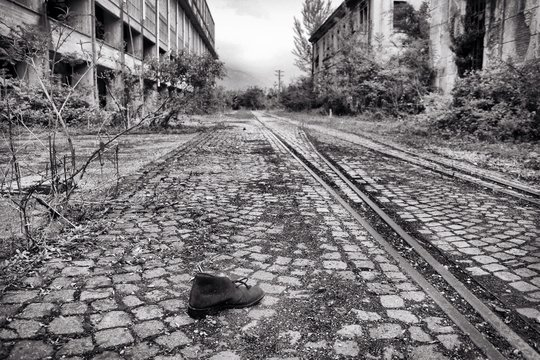 Abandoned Shoe On Cobbled Footpath