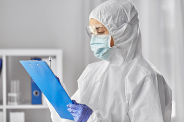 health safety, medicine and pandemic concept - close up of female doctor or scientist in protective...