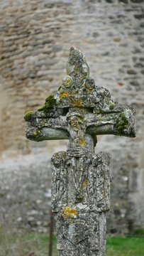 Close-up Of Weathered Crucifix At Cemetery