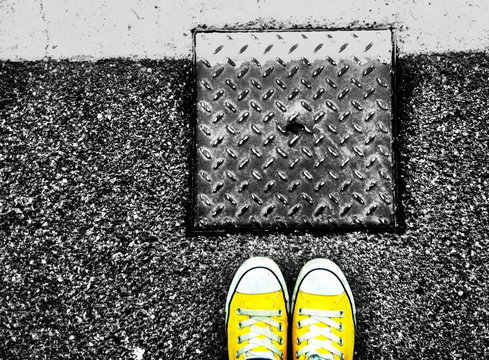 Yellow Canvas Shoes By Manhole Cover