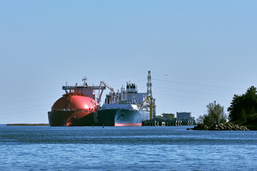 LNG tanker and carrier as floating LNG storage and import terminal in port. Alternative gas supply, commercial freight, energy crisis, diversification