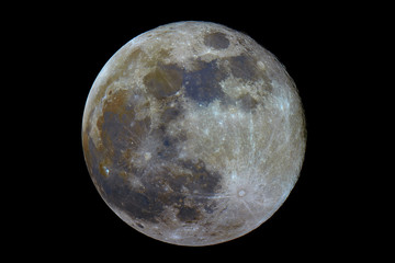 Full mineral Moon phase, isolated in the black space, with its natural colors, from red to blue, iron and titanium.