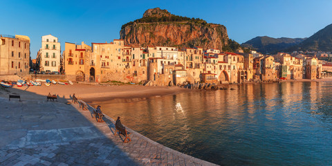 Fototapete - Beautiful panoramic view of coastal city Cefalu at sunset, Sicily, Italy